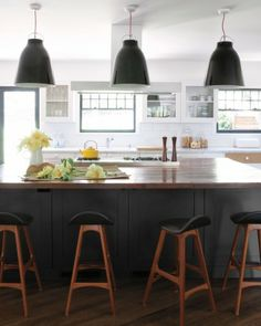 bright-ideas-kitchen-001-md108925.jpg  Use deep gray island with darker wood top and lights to break up lighter cabinetry (white).