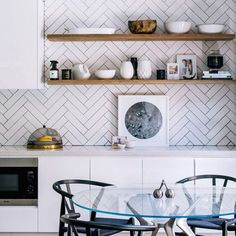 Herringbone subway tile kitchen backsplash, counter to ceiling behind open shelving?