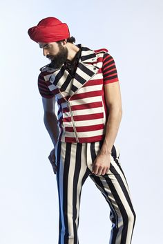 A bold,striking, Graphic look... Each piece on its on would work well but given maximum impact when worn together. Great model for this Jean Paul Gaultier oufit.