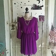 2 HR FLASH SALE Dress Forever 21 Lavendar dress.   Waistline has elastic for comfortable fit peek a boo back that buttons at neck line no zippers.  Sheer  see through sleeves NWOT. Great for parties, weddings or just having a girls night out. Forever 21 Dresses Midi