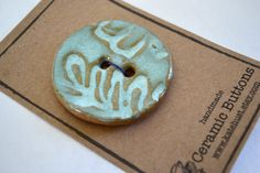 aqua leaf ceramic button - 2 inch circle. $6.00, via Etsy.