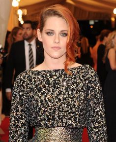 Kristen made her first red carpet appearance with her orange-red locks at the Met Gala, wearing cascading curls to one side.