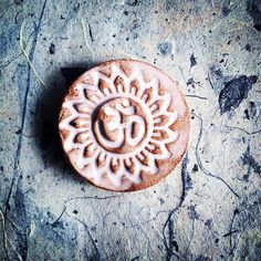 Om Ceramic Meditation Stone  People wonder what you use the stones for - here are a couple of ways I use them! 1. As a worry stone - I find them in all of my pockets! 2. To hold my focus in a balance pose I put them at the top of my yoga mat. 3. Good luck charms - since they are made with love they have great juju! 4. During meditation to help quiet my mind and focus. Check them out on my @etsy shop!