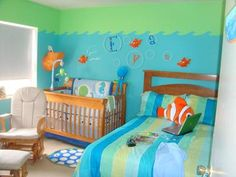 The best Ocean Themed Baby Nursery EVER. Our baby's fun ocean themed nursery has lots of bright colors like blue, green, orange and decorations that include tropical fish and sea creatures that