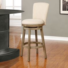 The big and tall Amaranthe swivel bar stool has a rustic, yet elegant look that offers instant style to your home decor. Upholstered in a natural linen-look fabric with a rounded back and circular seat, this graceful stool is both comfortable and fashion forward. Restoration finish.