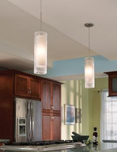 The mini-cylinder pendants from LBL Lighting's Rock Candy Collection are made of mouth-blown transparent glass with a pebbled texture. Available in five colors as well as a round globe pendant. www.lbllighting.com