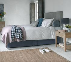 PIPER BED IN BLUE FRENCH STRIPE. The beauty of this comfy bed lies in its simplicity. We love the piping detail which requires many hours to get just right. Shown here with the handy Tight Space storage base.