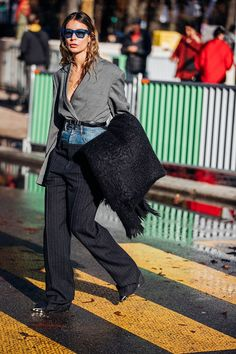 Street style star Irina Lakicevic was on hand at Paris Fashion Week to show us how deconstructed denim needn't be down tempo. Just add sleek tailoring and a Céline stole.