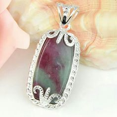 Beautiful Ruby Zoisite Pendant Sterling Silver Ruby Zoisite Pendant. Gemstone size: 32x15 mm. Pendant Length: 1 7/8 Inch Jewelry Necklaces