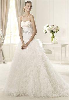 Liz will love this feathered wedding dress