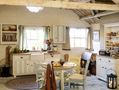 I love this kitchen, how informal and cozy it is.  But I don't like that the two curtains don't match.
