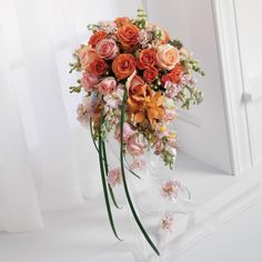 Bride's bouquet in orange, pink, green, and ivory/white