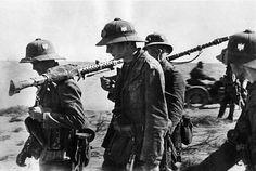 German soldiers from the Afrikakorps with MG 34 machine guns at Tobruk, Libya 1941.