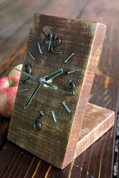 This clock is lovingly handcrafted from reclaimed wood and fitted with a quartz clock mechanism. We paint two slats of the clock in chalk paint and leave the th Clock Art, Diy Clock, Diy Wall Clocks, Homemade Clocks, Woodworking Plans, Woodworking Projects, Palette Deco, Cool Clocks, Wall Clock Design