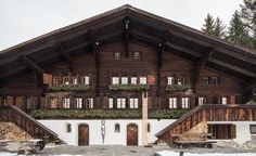 Gstaad SWISS:  An ash wood sled stands sentinel outside of a traditional Swiss chalet, looming comically over the front door at four metres tall. It seems poised for the slopes – surely the home's inhabitants are having a laugh? In fact, it's an artwork by the ...