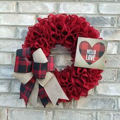 This wreath is made with red burlap ruffled on the frame and is a simple but very versatile design that can be left out all year.  Product Description: Handmade Wire Wreath Form 5.5 red burlap ribbon 2.5 burlap ribbon 2.5 red & black checkered ribbon Wood sign   Wreath Measures approx. 16 in diameter, 4 Deep  The elements and/or sign are securely attached and no glue was used in the process. This wreath is made to hang in a protected area outside or anywhere inside using appropriate ...
