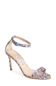 An English garden-like floral pattern adorns this iconic, streamlined ankle-strap sandal from Manolo Blahnik.