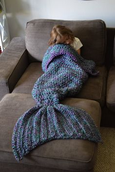 Indulge your mermaidy dreams. Mermaid tail knitted blanket. So cute and cozy.