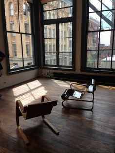 Room in Donald Judd's SoHo loft.  Love these floor to ceiling windows.