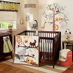 Transform your bundle of joy's nursery into a whimsical jungle with the adorable Lambs & Ivy Treetop Buddies Crib Bedding Collection. Your little one will love cuddling with Tommy the tiger, Elmer the elephant, Max the monkey, and Liam the lion.