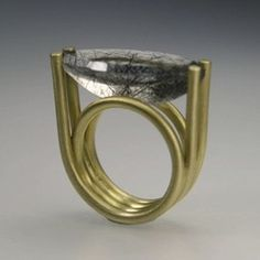 Ela Cindoruk. I love this ring. Two pieces of wire wound like a spring. The seat, the prongs, the dimensions...all just right for a memorable and simple setting.