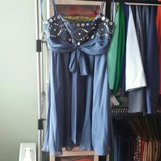 Beautiful formal dress Gorgeous flowy blue dress with sequins and bragging at top. Perfect for a wedding or formal event. Worn but great condition and dry cleaning tags are still on. BCBGMaxAzria Dresses
