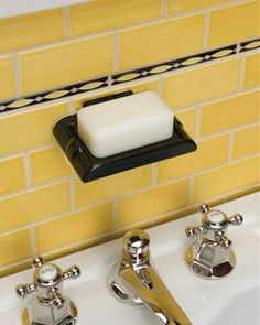 Mississippi faucet with mini subway tiles.