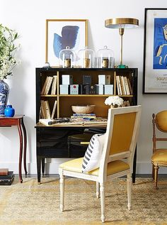 "For a small corner office, ""we felt that yellow was a primary spring color that provided a bold pop to a room that usually isn't known for its flair,"" says Alyssa of the yellow silk rug, the golden art and accents, and the sunny leather-upholstered side chair."