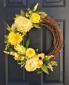 Yellow spring wreath for front door, spring wreath, yellow wreath, yellow summer wreath, yellow spring decor, spring wreathes, spring decor  As winter winds down its nice to see color again. This stunning yellow spring wreath is sure to be the envy of the neighborhood. Did you know yellow emotes happiness, brightness, and energy. Makes a great Mothers day gift, birthday gift, housewarming gift or a lovely gift for yourself.  Measurements are Height 22 around by 5 depth  All of my wreaths are…