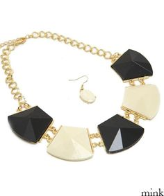 beautiful gold necklace with black & ivory square pieces