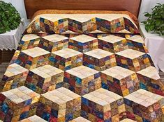 Tumbling Blocks Quilt. Lovely hand painted Batik style fabrics give the classic Tumbling Blocks design a whole new look!. Another wonderful creation of C Jean Horst. Excellent patchwork piecing and lots of exceptionally fine quilting. Made by Lancaster County Amish woman.