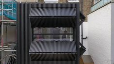 Completed in 2018 in Islington, United Kingdom. Images by Peter Landers. Black Box is a small first floor rear extension to a mid-terrace Victorian-era house in Islington. Our client, a couple, wanted a space that could. Brick Extension, Rear Extension, Large Windows, Wooden Shutters, Recycled Brick, Deck With Pergola, Pergola Ideas, Victorian Terrace, Flats