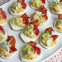 Loaded Deviled Eggs are fully loaded with cheddar cheese, bacon, chives, and a touch of horseradish for a little zing. You will want to serve them at every holiday and party! Bacon Deviled Eggs, Deviled Eggs Recipe, Scrambled Eggs, Blt Recipes, Easter Recipes, Recipes Dinner, Dinner Ideas, Dessert Recipes, Tapas