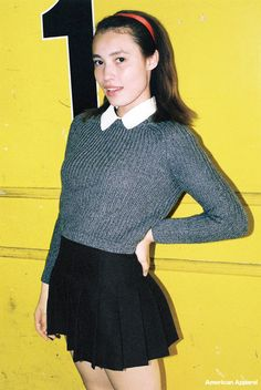 Rurika wears the Round Collar Short Sleeve Button-Up, Cropped Fisherman Pullover and Tennis Skirt. Japan, August 2014.