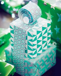 Gift wrap ideas! Inspiration for wrapping sets of gifts and unusually shaped gifts. #giftwrap #emballagecadeau