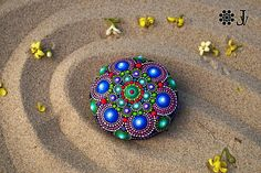 This mandala stone is approximately 8 cm (3,1 inch) in diameter and 270 gr. This is a gorgeous Mandala Stone so vibrant, colorful and tactile! I find this stone on beach of the Ionic Sea in Italy. I hand painted this special stone with acrylic paint and brush and then protect it
