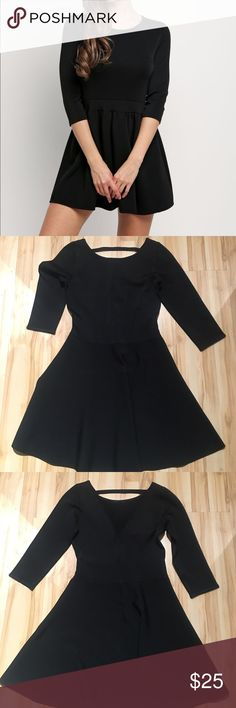 Guess Marciano Fit Flare Bandage Dress Gorgeous black fit and flare Bandage dress with three quarter sleeves. Very high quality heavy material! Super flattering! Brand new, no tags - cut out to prevent store return.  Small hole was sewn at back. Guess by Marciano Dresses Mini