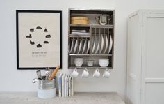 A beautifully simple plate rack consisting of hooks, slots and shelves,This product works well on its own. But two can be put side by side for more impact!This utilitarian plate rack is a timeless kitchen storage unit that consists of: 5 Slots for main plates. They are large and can actually hold at least 10 plates if you double them up. 5 Slots for side plates. Can also double up to hold at least 10. 4 Cup/utensil hooks 3 Shelves 6 Cutlery slotsStainless steel. The plate racks are hand cut…
