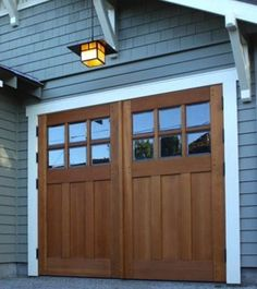 Carriage Doors on a blue Carriage House. Carriage Doors on a blue Carriage House. House Colors, Garage Door Design, Garage House, Exterior Design, Craftsman Bungalows, House, Craftsman House, Garage Door Types, House Exterior