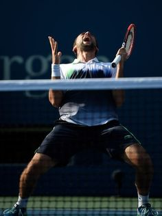 Marin Cilic celebrates after recording match point to defeat Tomas Berdych.
