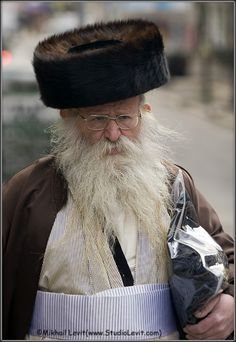 "Jerusalem-A shtreimel is a fur hat worn by many married haredi Jewish men, particularly (although not exclusively) members of Hasidic groups, on Shabbat and Jewish holidays and other festive occasions. In Jerusalem, the shtreimel is also worn by ""Yerushalmi"" Jews (non-Hasidim who belong to the original Ashkenazi community of Jerusalem, also known as Perushim)."