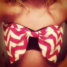 """DIY Bow Bandeau Bikini  Buy a bandeau top (I got this one at Walmart for $3) and 1/2 a yard of sturdy fabric for the bow (I recommend """"duck"""" fabric from Hobby Lobby or any craft store). Sew a double sided rectangle the length of your chest and the width just slightly more than the bandeau. Sew another small rectangle just small enough to wrap and cinch the center of the bow. Once the bow is finished, attach it to the bandeau in three places: the center, and top corners."""