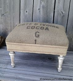 Grain Sack Ottoman   what a great (and easy!) way to reupholster a small bench or footstool
