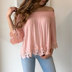 Off the shoulder trend is one of our absolute favorite and the Ava Top is on top of our list! A soft pink hued and white top with intricate lace detail on the hem and sleeves. Incredibly romantic and