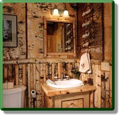 "Keeping it natural in a very ""Adirondack"" style campy bathroom with small birch logs for wainscoting, and birch cuts above"