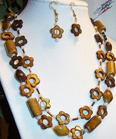 Wood Shapes and Shell Daisies Necklace Earrings  and Two Bracelets Set. $14.99, via Etsy.