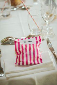 pink striped favor bags, photo by Studio A+Q http://ruffledblog.com/normandy-summer-wedding #favors #wedding