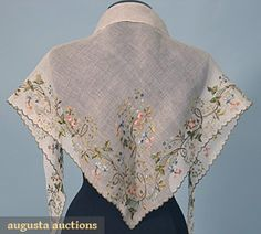 Embroidered fichu, c1780. Fine white mull with colored silk and gold thread embroidery in leaf, vine, and floral spray pattern, scalloped edge worked in gilt thread, 37in x 62in