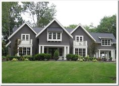 Gray / grey exterior with white trim. The color is Wendigo by Pratt & Lambert.