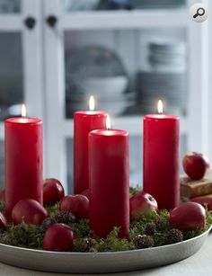 Easy centerpiece for the kitchen or dining, red pillar candles, apples, greenery, and round platter